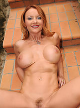 Hot brunette Anilos Janet Mason showing all her glory and toying her own pussy on the stairs