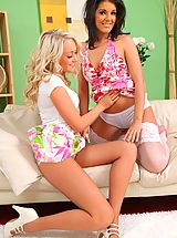 Lesbians Pics: Kelly M and Lucy Anne make a real treat as they slowly help each other to get off cute summer outfits.
