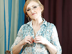 Sensitive Nipples, Sweet grandmother with glasses slowly unbuttons her blouse