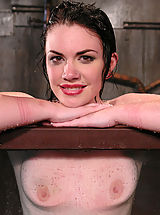Kink Pics: Sexy, glamorous brunette is bound sprayed and dunked.