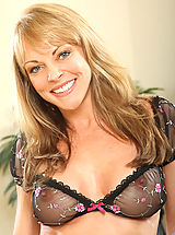 Naked Anilos, Lovely cougar Shayla Laveaux caresses her pussy while massaging her big boobs in bed