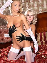 nipples hard and sore, Gorgeous girls Malgina and Kira strip each other down to their stockings on the bed.