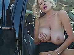 Breastfeeding Nipple, Kelly strips out of her suit to play with her huge tits and tight pussy in the car.