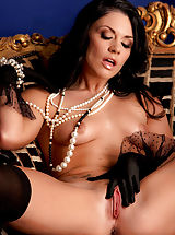 Andy San Dimas is fine n' dandy in pearls, stockings & heels and nothing else!