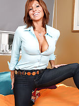 Anilos Tara Holiday opens her blouse to reveal her tempting cleavage