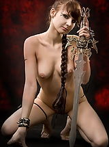 Vintage Fashion, Fantasy Girl Sexy warrior girl with the sword and tatoos on her back and belly