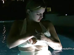 Danielle plays in the pool at night