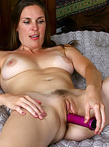 naked girl, Anilos Laila fucks her cougar snatch with a purple toy in bed