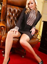 Upskirt Pics: Blonde slips out of her tight black knee-length skirt suit and reveals her sexy lingerie.
