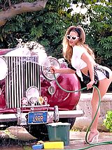 Vintage Pics: A sizzling redhead knows how to ride in style.