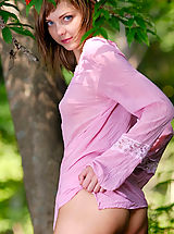 Armour Angels Nippels, Fabulous nude kitten is sitting in the forest in bright read garland and poses energetically in front of the camera.