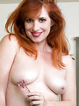 puffy boobs, Wild redhead Amber Dawn gets dressed in her favorite leopard spot leotard and lets you admire her full bodied curves before working her clothes away from her most important bits. It's not long before she has put her magic fingers and a slim dildo to work