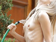 Nipple Sucking, Petite blonde Chastity Lynn brings ultimate pleasure to her hot pussy with a cool stream of water from the garden hose