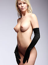 Pillow Biter, Nicole poses with picture perfect elegance wearing nothing but a pair of black satin gloves.