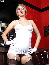 Katie Kay gets down to her corset and rht nylons in this pub striptease!