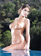 naked asian, August Ames exposes her naked tits, pulls down her panties and opens her thighs and stimulates her tight pussy