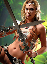 True Beauty Nippels, Sexy topless blonde amazon babe posing with two swords and masturbates