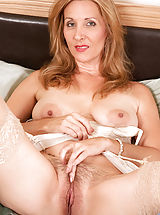 Hard Nipples, Sex starved cougar Camilla shoves a big suction cup dildo deep inside of her hairy juice box