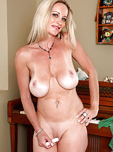 [Spintax1], Milf Cassy Torri flaunts her big tits and pleasures herself with a purple vibrator