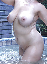 Nipples always hard, Attractive 30+ Mother exposes her well coached vagina Bubbly busty Danielle T pours water over those big soft titties in the pool