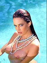 Hard Nipples, Ms. lovely legs Nikki Nova spreads them for you around a rock star's pool.