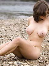 Puffy Boobs, Brunette with big breasts posing naked on the beach